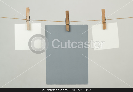 Memory note papers hanging on cord stock photo, white memory note papers hanging on cord by Artush