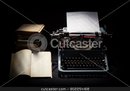 retro typewriter with stack of book and one opened book  stock photo, retro typewriter with stack of book and one opened book black background by Artush