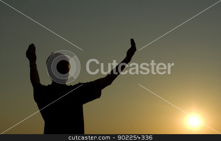 help stock photo, A man stands on against a sun with heaved up hands       by Vitaliy Pakhnyushchyy