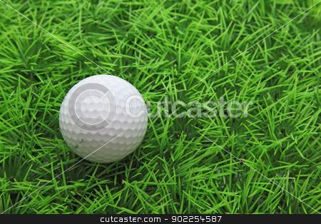 closeup of golf ball on green grass stock photo, closeup of golf ball on green grass by Vichaya Kiatying-Angsulee