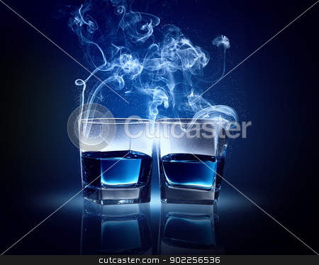 Two glasses of blue cocktail stock photo, Two glasses oC0 blue cocktail with fume going out by Sergey Nivens