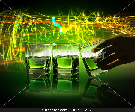 Three glasses of green absinth stock photo, Hand holding one of three glasses of green absinth with fume going out by Sergey Nivens
