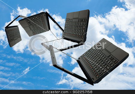 Cloud Computing stock photo, Cloud Computing - Flying Notebooks on Summer blue sky with clouds by JAMDesign