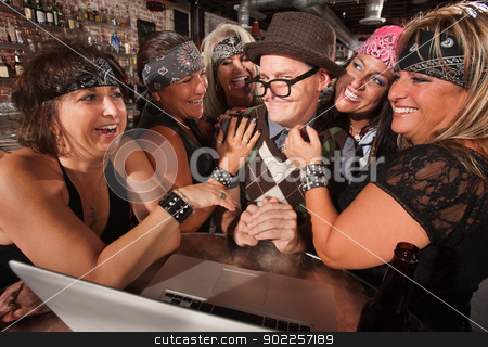 Biker Women Flirting with Computer Geek stock photo, Motorcycle gang members flirting with happy nerd on laptop by Scott Griessel