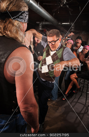 Nerd Threatening Gang Member stock photo, Nerd threatening strong gang member with martial arts by Scott Griessel