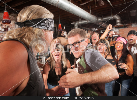 Nerd with Karate Chop in Bar Fight stock photo, Nerd readies a karate chop in fight with gang member by Scott Griessel
