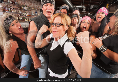 Nerd Flexing with Gang stock photo, Cute female nerd flexing muscles with gang of bikers by Scott Griessel
