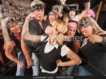 Gang Cheering On Nerd Flexing stock photo, Biker gang cheering on skinny female nerd flexing muscles by Scott Griessel
