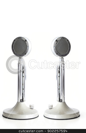 retro Microphones stock photo, two retro Microphones on white table with its reflection by Vichaya Kiatying-Angsulee