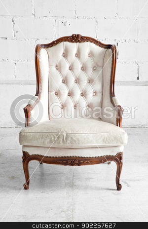 White Sofa stock photo, White genuine leather classical style sofa in vintage room by Vichaya Kiatying-Angsulee
