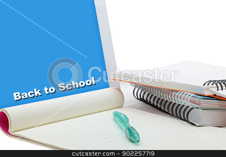 Stationery set with touch screen tablet stock photo, touch screen tablet with yellow papet pen and books for e-learning concept by Vichaya Kiatying-Angsulee