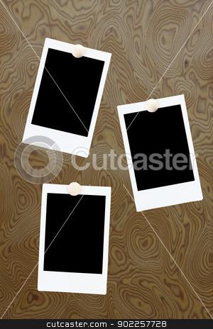 blank polaroids frames on a wood background stock photo, blank polaroids frames on a wood background by Vichaya Kiatying-Angsulee