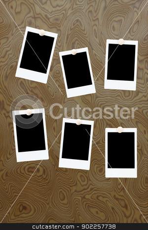 six blank polaroids frames on a wood background stock photo, six blank polaroids frames on a wood background by Vichaya Kiatying-Angsulee