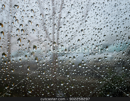 Rainy Day stock photo, Sight to the moody and  rainy day through raindrops on a window by Sinisa Botas