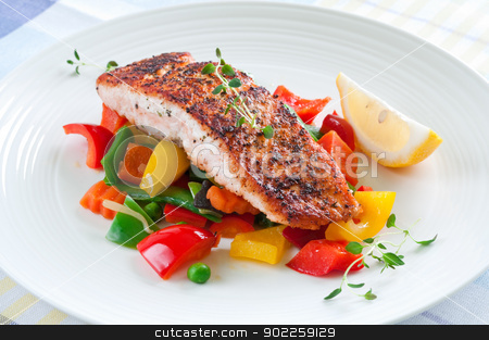 Salmon with vegetables stock photo, Grilled salmon with vegetables, herbs and lemon by Tiramisu Studio