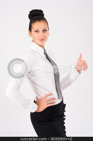 Attractive woman with thumb up stock photo, Young businesswoman showing ok gesture (thumb up) at white background by Aikon