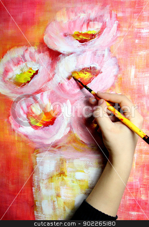 Artist paints a picture stock photo, Artists hand holding a paintbrush and paints beautiful picture by Tatiana Mihaliova