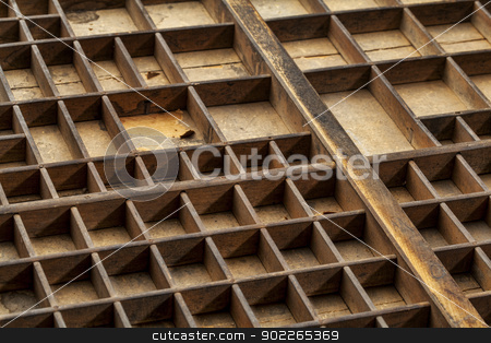 old typesetter drawer stock photo, detail of vintage dusty grunge wood typesetter drawer with dividers by Marek Uliasz
