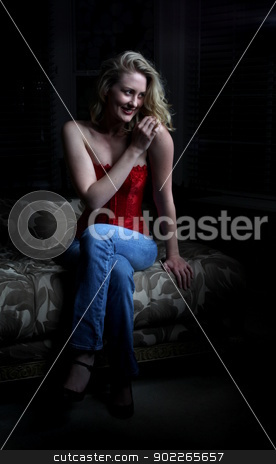 Sexy Blond Sitting stock photo, Sexy blond woman sitting in the dark. by Henrik Lehnerer