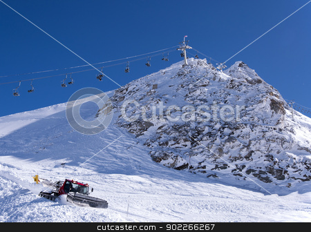 Chair lift and snow groomer stock photo, Chair lift and snow groomer at Hintertux Glacier in Zillertal Alps in Austria by Krzysztof Nahlik