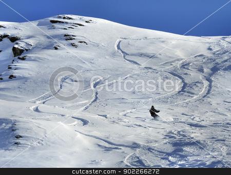Snowboarder stock photo, Snowboarder and off-piste tracks on snow in sunset light by Krzysztof Nahlik