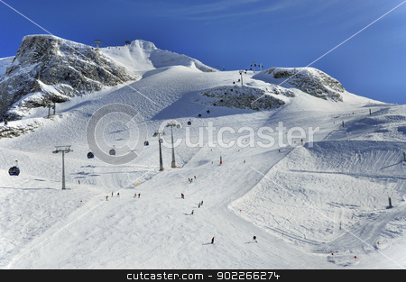 Ski runs on slopes of Hintertux Glacier stock photo, Hintertux Glacier with gondolas, ski runs and skiers in Ziilertal Alps in Austria by Krzysztof Nahlik