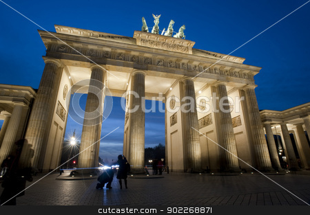 Brandenburg Gate illuminated at night stock photo, Low angle view of the historical Brandenburg Gate, or Brandenburger Tor, Berlin, Germany illuminated at night by Stephen Gibson