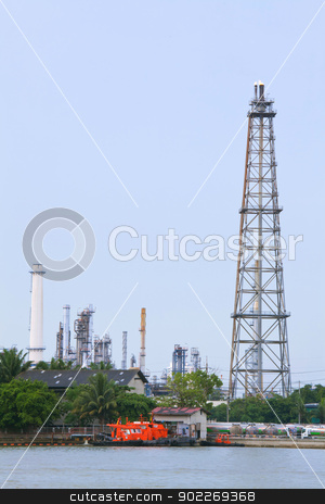 distillation Tower  stock photo, Oil Refinery distillation Tower over river by Vichaya Kiatying-Angsulee