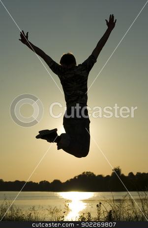 guy in jump stock photo, Young guy in jump on background dark  sky        by Vitaliy Pakhnyushchyy