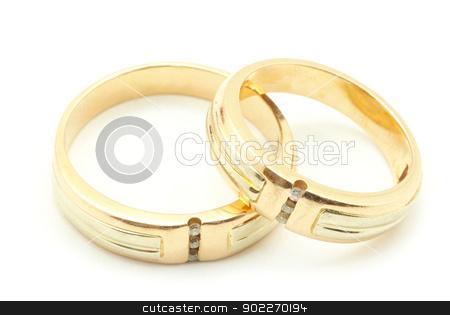 rings  stock photo, Gold wedding rings isolated on white background by Vitaliy Pakhnyushchyy