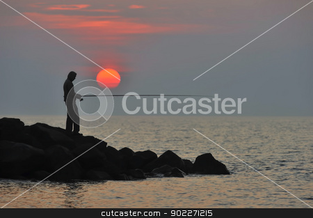 The fisherman stock photo, The fisherman at sunset is waiting for fish to bite by lillo