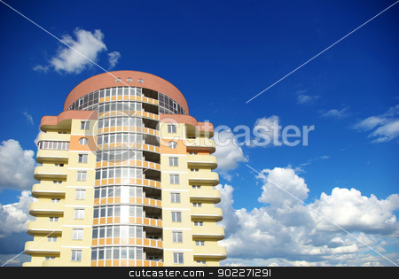 modern apartments stock photo, A modern apartments building on sky by Vitaliy Pakhnyushchyy