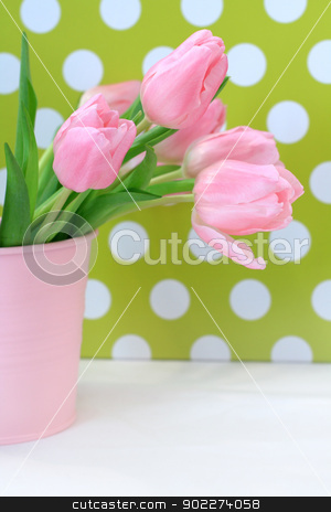 Beautiful tulips in a pink vase  stock photo, Beautiful tulips in a pink vase against polka dots background by Juliet Photography