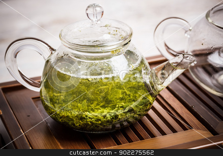 Green tea  stock photo, Transparent teapot with green tea  by Grafvision