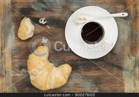 croissant and coffee stock photo, croissants and cup of coffee on grunge painted wood by Marek Uliasz