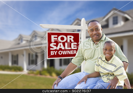 Father and Son In Front of For Sale By Owner Sign and House stock photo, African American Father and Son In Front of For Sale By Owner Real Estate Sign and House. by Andy Dean