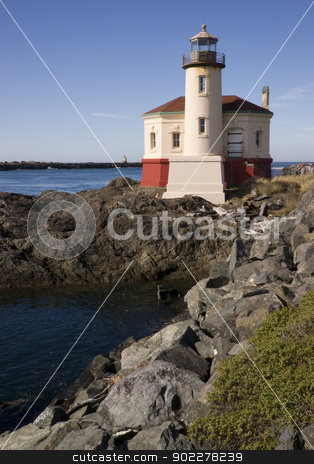 Coquille River Lighthouse stock photo, West Coast Lighthouse on a rocky jetty by Christopher Boswell