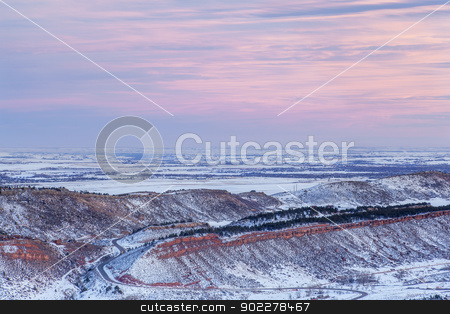 winter dusk over Colorado stock photo, winter dusk over foothills of Rocky Mountains and prairies near Fort Collins, Colorado by Marek Uliasz