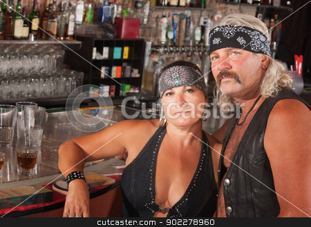 Biker Gang Couple stock photo, Serious middle aged biker gang couple at bar by Scott Griessel