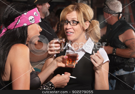Nerd Talking and Drinking with Woman stock photo, Blond woman and biker gang lady talking while smoking and drinking by Scott Griessel