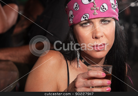 Sad Woman with Whiskey stock photo, Sad mature white woman with pink bandanna and glass of alcohol by Scott Griessel