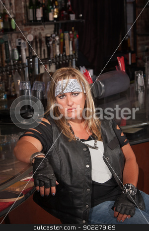 Annoyed Female Gang Member stock photo, Annoyed female motorcycle gang member sitting in bar by Scott Griessel