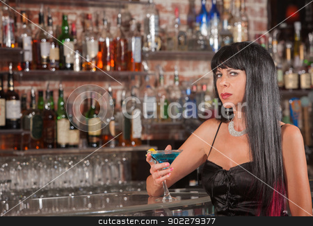 Sultry Woman with Martini stock photo, Sultry mature woman in black dress with blue martini by Scott Griessel