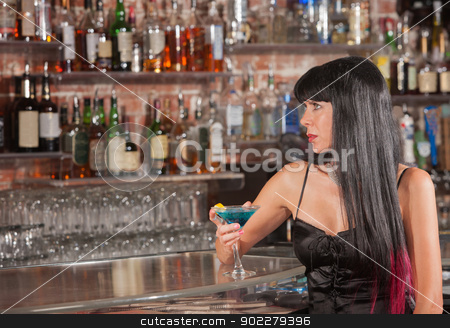 Serious Woman in Bar with Drink stock photo, Serious beautiful woman at a bar looking up by Scott Griessel