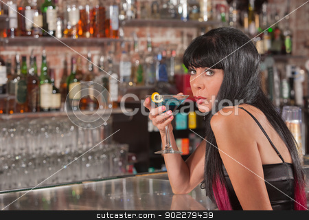 Woman Drinking and Looking Over stock photo, Beautiful mature white female holding martini and looking over by Scott Griessel