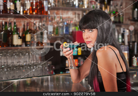 Seductive Woman Drinking stock photo, Seductive European female with blue martini in a bar by Scott Griessel