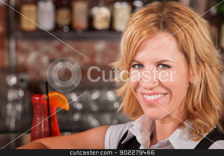 Blond Lady with Drink stock photo, Close up of blond woman in cafe with drink by Scott Griessel
