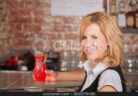 Happy Waitress with Drink stock photo, Happy hostess with alcoholic beverage glass in bar by Scott Griessel