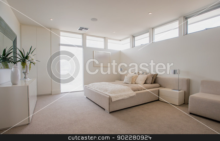 Spacious Modern Bedroom stock photo, Spacious and elegant new modern bedroom. Room consists of bed, couch, dresser and cupboard. by thisboy