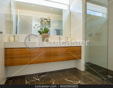 Modern Bathroom stock photo, A beautiful modern bathroom. This bathroom is very elegant with wooden cabinets and stylish shower and wash basins by thisboy